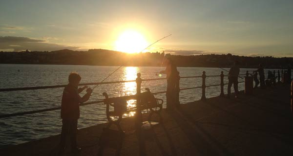 Child fishing at Princess pier.